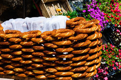 Bagel Sellers Stand. Typical stand of a Turkish bagel simit seller next to a local florist under the bright sun light of a warm summer day. Turkish simit is a Royalty Free Stock Photography