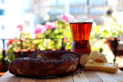 Bagel Simit with tea on wooden surface Royalty Free Stock Photography
