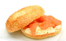 Bagel with smoked salmon on plate Stock Photography