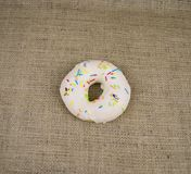 Bagel sprinkled with colored glaze, there is free space to fill stock photo