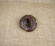 Bagel sprinkled with colored glaze, there is free space to fill royalty free stock photos