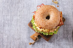 Bagel with stew and fried onion Royalty Free Stock Images