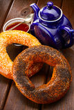 Bagel and tea for breakfast Stock Photos