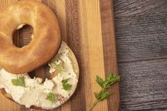 Bagel topped with cream cheese and chives. Taken with copy space stock photos