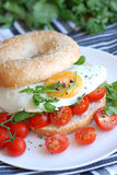 Bagel With Egg And Tomatoes Stock Images