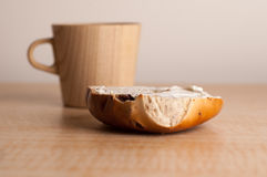 Bagel with Wooden Mug Stock Images