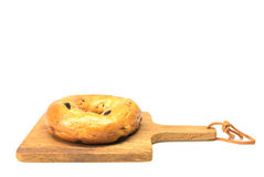 Bagel on a wooden plate Stock Photos
