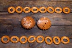 Bagels και δύο cupcakes Στοκ Εικόνες