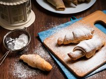 Bagels on a bamboo board sprinkled with powdered sugar Royalty Free Stock Photography