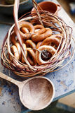 Bagels in a basket. On a table next to a wooden spoon royalty free stock photography