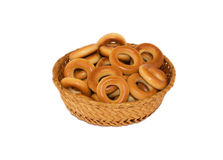 Bagels in a basket. On a white background isolated Stock Photography
