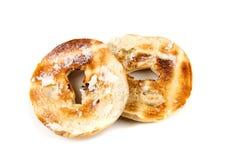 Bagels beurrés grillés blancs simples Image libre de droits
