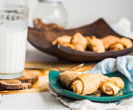 Bagels biscuits from short pastry stuffed with condensed milk in Stock Images