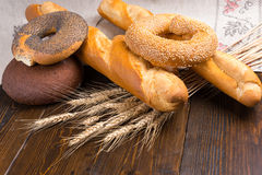 Bagels, bread and baguettes on table Royalty Free Stock Photo