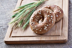 Bagels on bread board Stock Image