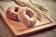 Bagels on bread board Royalty Free Stock Photo