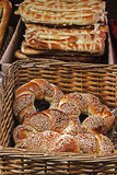 Bagels and bread in wicker baskets Royalty Free Stock Image