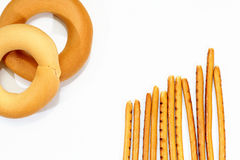 Bagels and breadsticks isolated on white. Background Royalty Free Stock Photos