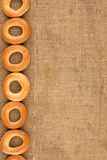 Bagels are on burlap Stock Photography