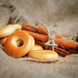 Bagels and cinnamon on the sacking background Stock Photos