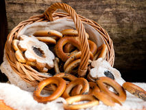 Bagels and cookies scattered from wicker basket Royalty Free Stock Photo