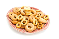Bagels on a dish. Many different bagels on a plate closeup on white background Stock Photos