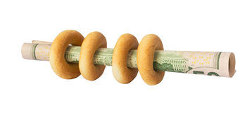Bagels with dollars Stock Image