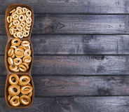 Bagels drying of different sizes. On gray wooden background bagels drying of different sizes royalty free stock photo