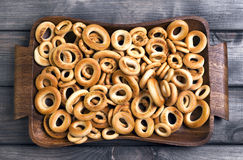 Bagels drying of different sizes. On gray wooden background bagels drying of different sizes royalty free stock photos