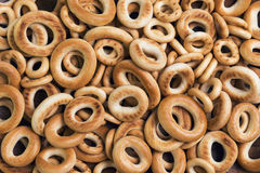 Bagels drying of different sizes. On gray wooden background bagels drying of different sizes royalty free stock images