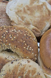 Bagels and english muffins. Mix of bagels and muffins resting on toaster Stock Photo