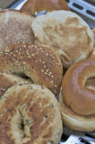 Bagels and english muffins. Mix of bagels and muffins resting on toaster Royalty Free Stock Photos
