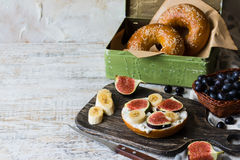 Bagels with fig and banana on curd cheese Stock Images