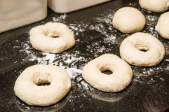 Bagels formed and ready to bake Stock Photo