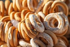 Bagels with glaze and poppy seeds. A lot of bagels royalty free stock photos
