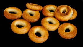 Bagels of golden color isolated royalty free stock photos