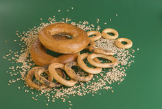 Bagels and grains. Group of some bagels and grains on a green background Royalty Free Stock Images