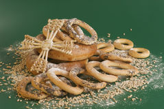 Bagels, grains, flour and fan on green. Royalty Free Stock Photos