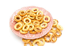 Bagels on pink dish. Bagels on a plate on white background Stock Photo