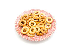 Bagels on pink dish on white. Bagels on a plate closeup on white background stock photography