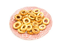 Bagels on pink plate on white. Bagels on plate on white background closeup Stock Photos