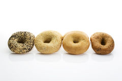 Bagels with poppy seeds bagels with sesame wholemeal bagels on white background Stock Images