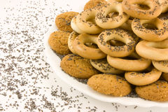 Bagels with poppy seeds and pastry to tea Royalty Free Stock Photography