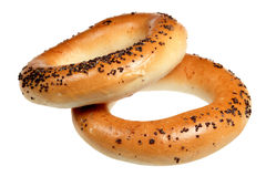 Bagels with poppy on white Stock Images