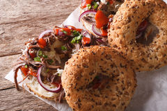 Bagels with Pulled pork, onions, cabbage and sauce close-up Stock Photo