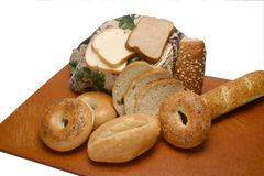 Bagels Rolls Bread on Board Royalty Free Stock Photo
