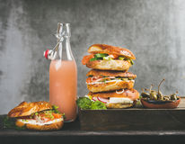 Bagels with salmon, eggs, vegetables, capers, cream-cheese and grapefruit lemonade Royalty Free Stock Photos