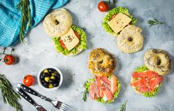 Bagels with salmon, vegetables, cream-cheese on grey concrete background Stock Photography