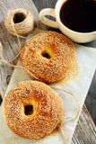 Bagels with sesame seeds and black coffee. Royalty Free Stock Image