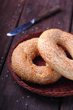 Bagels with sesame seeds. On wood royalty free stock image